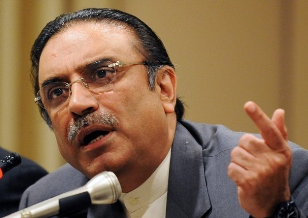 "Asif Ali Zardari, co-chairman of Pakistan People's Party (PPP) gestures as he addresses a news conference after attending a conference of the Socialist International Asia-Pacific Committee in Islamabad on May 30, 2008.  Former premier Nawaz Sharif said he and the widower of slain opposition leader Benazir Bhutto, Asif Ali Zardari, had agreed in talks on May 28 to oust President Pervez Musharraf in the wake of the coalition's victory in February elections. Musharraf on May 29 dismissed speculation that he was going to resign, blasting ""rumour-mongers"" for spreading stories that he has lost the army's support. AFP PHOTO/Aamir QURESHI (Photo credit should read AAMIR QURESHI/AFP/Getty Images)"