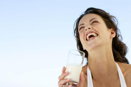 woman-laughing-drinking-milk-136381487773810401-130708122901