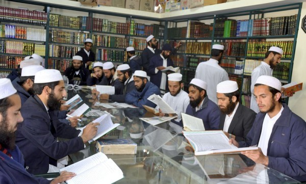 (RNS1-dec22) The students of Institute of Islamic Sciences study during a library class. For use with RNS-PAKISTAN-MADRASSA, transmitted on December 22, 2014, Religion News Service photo by Naveed Ahmad.