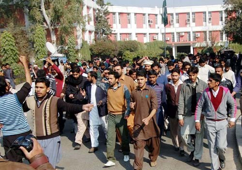 LAHORE, PAKISTAN, DEC 22: Punjab University (PU) students are protesting in favor of their demands during demonstration after clash between two students groups at university premises in Lahore on Thursday, December 22, 2011. (Babar Shah/PPI Images).