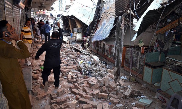 Pakistani residents gather at a damaged market following an earthquake in Sargodha on October 26, 2015. A powerful 7.5 magnitude earthquake killed at least 70 people as it rocked south Asia, including 12 Afghan girls crushed to death in a stampede as they tried to flee their collapsing school. Thousands of frightened people rushed into the streets in Afghanistan, Pakistan and India as the quake shook a swathe of the subcontinent. AFP PHOTO / SHAHID BUKHARI